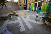 """13th Biennale of Architecture..Hong Kong exhibition: """"Inter Cities/Intra Cities: Ghostwiriting The Future""""..A piece of runway in the courtyard."""