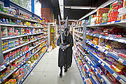 UNITED KINGDOM, London: 27 October 2013. <br /> Comic Con Feature.<br /> A comic con fan dressed in cosplay walks through a supermarket situated next to the ExCel Arena during the MCM Comic Convention 2013.<br /> Photo: Rick Findler / Story Picture Agency