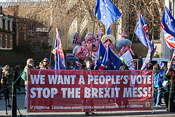 London, UK. 11th December, 2018. Pro-EU activists protest outside Parliament on the day on which a vote was originally to have been scheduled on completion of a House of Commons debate on the Government's draft Brexit withdrawal agreement.