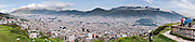 """Quito, capital city of Ecuador, wraps around the eastern slopes of Pichincha, an active volcano. The mountain's two highest peaks are the Guagua (15,696 feet/4,784 m), which means """"child"""" in Quechua and the Rucu (15,413 feet/4,698 m), which means """"old person"""". The active caldera is in the Guagua, on the western side of the mountain. Guagua is usually accessed from the village Lloa outside of Quito. In October of 1999, the volcano erupted and covered the city with several inches of ash. Prior to that, the last major eruption was in 1660, when about a foot of ash fell on the city. On May 24, 1822, in the context of the war of independence of Latin American, Patriot forces defeated a Spanish colonial army on the slopes of the Pichincha. The encounter, known as the Battle of Pichincha, sealed the independence of the lands that constitute modern Ecuador. San Francisco de Quito, most often called Quito, is the capital city of Ecuador (and of Pichincha province) in northwestern South America. This city of 1.4 million people (as of the 2001 census) is located in the Guayllabamba river basin. Panorama was stitched from 7 overlapping photos."""