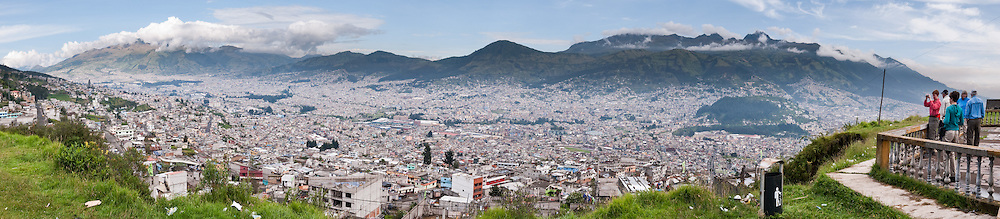 "Quito, capital city of Ecuador, wraps around the eastern slopes of Pichincha, an active volcano. The mountain's two highest peaks are the Guagua (15,696 feet/4,784 m), which means ""child"" in Quechua and the Rucu (15,413 feet/4,698 m), which means ""old person"". The active caldera is in the Guagua, on the western side of the mountain. Guagua is usually accessed from the village Lloa outside of Quito. In October of 1999, the volcano erupted and covered the city with several inches of ash. Prior to that, the last major eruption was in 1660, when about a foot of ash fell on the city. On May 24, 1822, in the context of the war of independence of Latin American, Patriot forces defeated a Spanish colonial army on the slopes of the Pichincha. The encounter, known as the Battle of Pichincha, sealed the independence of the lands that constitute modern Ecuador. San Francisco de Quito, most often called Quito, is the capital city of Ecuador (and of Pichincha province) in northwestern South America. This city of 1.4 million people (as of the 2001 census) is located in the Guayllabamba river basin. Panorama was stitched from 7 overlapping photos."