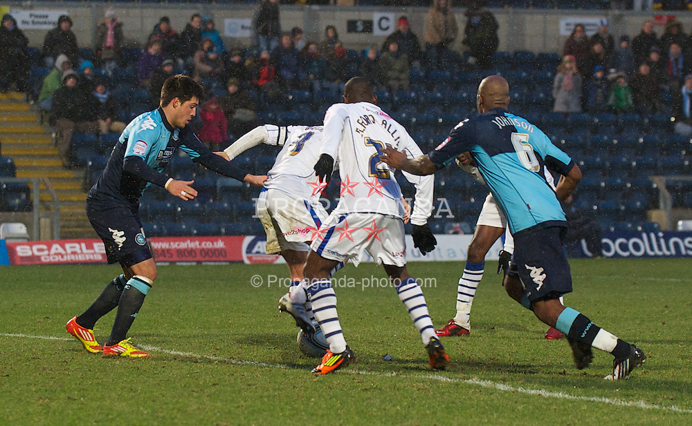 WYCOMBE, ENGLAND - Saturday, February 4, 2012: Tranmere Rovers' Lateef Elford-Alliyu is played onside by Wycombe Wanderers' Grant Basey before scoring an injury time equalising goal, only for the assistant referee to rule it out for offside, during the Football League One match at Adams Park. (Pic by David Rawcliffe/Propaganda)