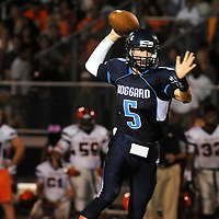 Hoggard High School's Austin Schoenleber looks to pass against New Hanover Friday October 3, 2014 in Wilmington, N.C. (Jason A. Frizzelle)