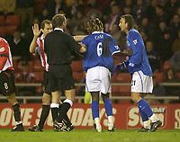 Photo. Glyn Thomas.<br /> Sunderland v Birmingham. FA Cup fifth round.<br /> Stadium of Light, Sunderland. 14/02/2004.<br /> Tempers flare as Birmingham's Aliou Cisse (C) is held apart from Sunderland's Kevin Kyle (L).