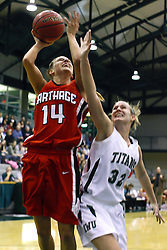 29 January 2011: Hope Schulte gets caught out of position to defend a shot by Diana Jacklin during an NCAA Womens basketball game between the Carthage Reds and the Illinois Wesleyan Titans at Shirk Center in Bloomington Illinois.