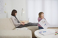 Mother and daughter in living room