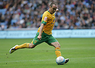 Coventry - Saturday August 9th, 2008: Lee Croft of Norwich City gets his shot away against Coventry City during the Coca Cola Championship match at The Ricoh Arena, Coventry. (Pic by Michael Sedgwick/Focus Images)