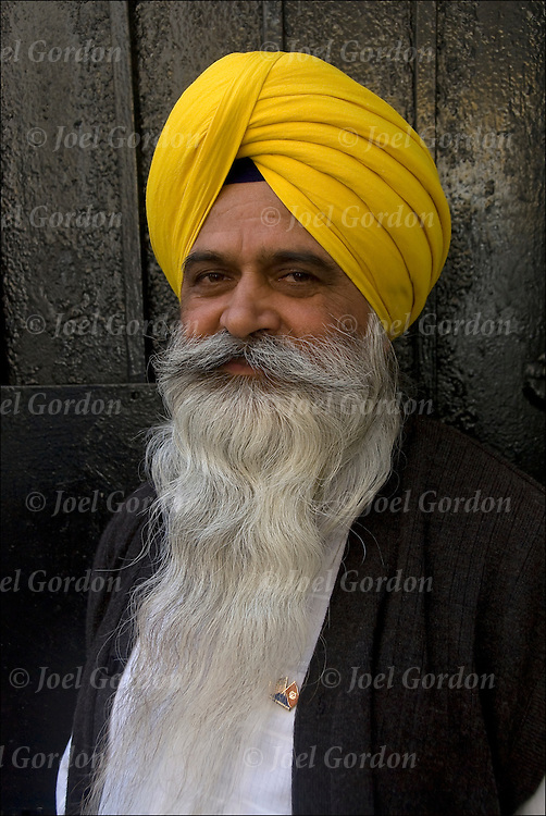 "Portrait of  Sikh-American. Showing ethnic pride, man with turban usually means he's a Sikh. Religion is called Sikhism, come from the state of Punjab in India, believe in one g-d and do not worship idols, fifth largest monotheistic religion. call g-d ""Wahegura"" meaning ""the supreme teacher"" never cut their hair, believe that men and women are born equal, in monogramy and reincarnation."