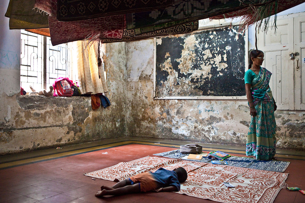 A child sleeping during class at the Kamatipura Centre in Mumbai. The centre welcomes about 100 children every day from the surrounding red-light district..The centre is run by the Prerana organisation who specialise in children of the red-light districts in Mumbai.