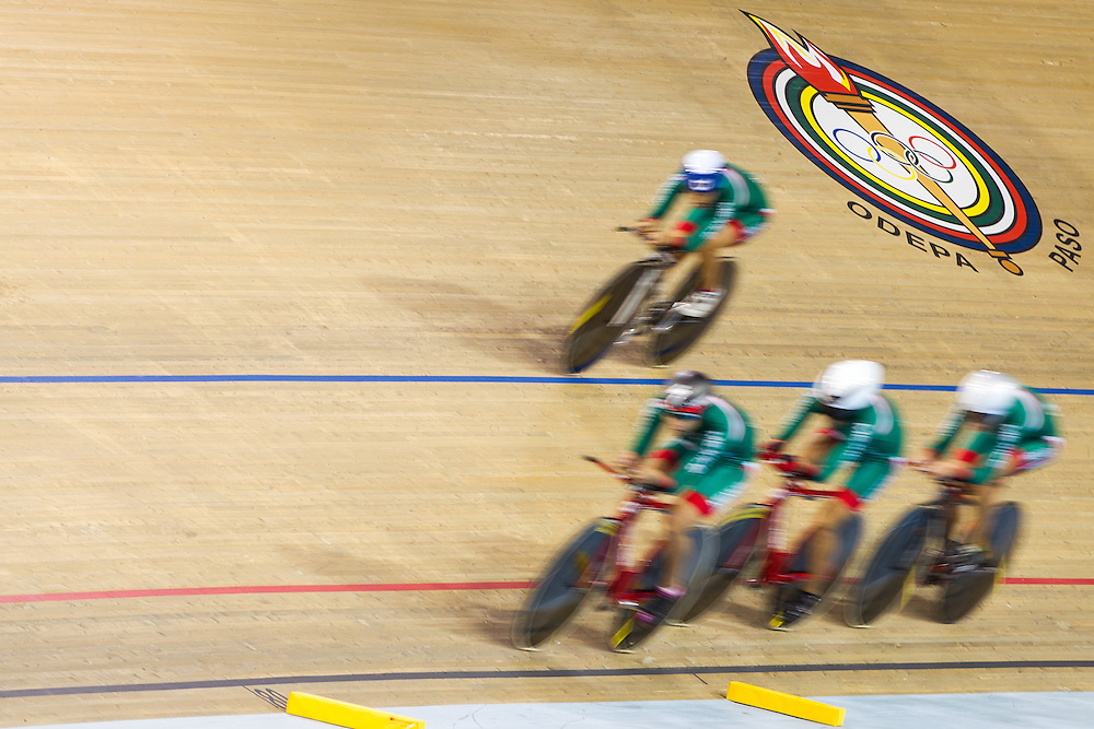 The Mexican team competes in the women's team pursuit qualification on the fist day of track cycling at the 2015 Pan American Games in Toronto, Canada, July 16,  2015.  AFP PHOTO/GEOFF ROBINS