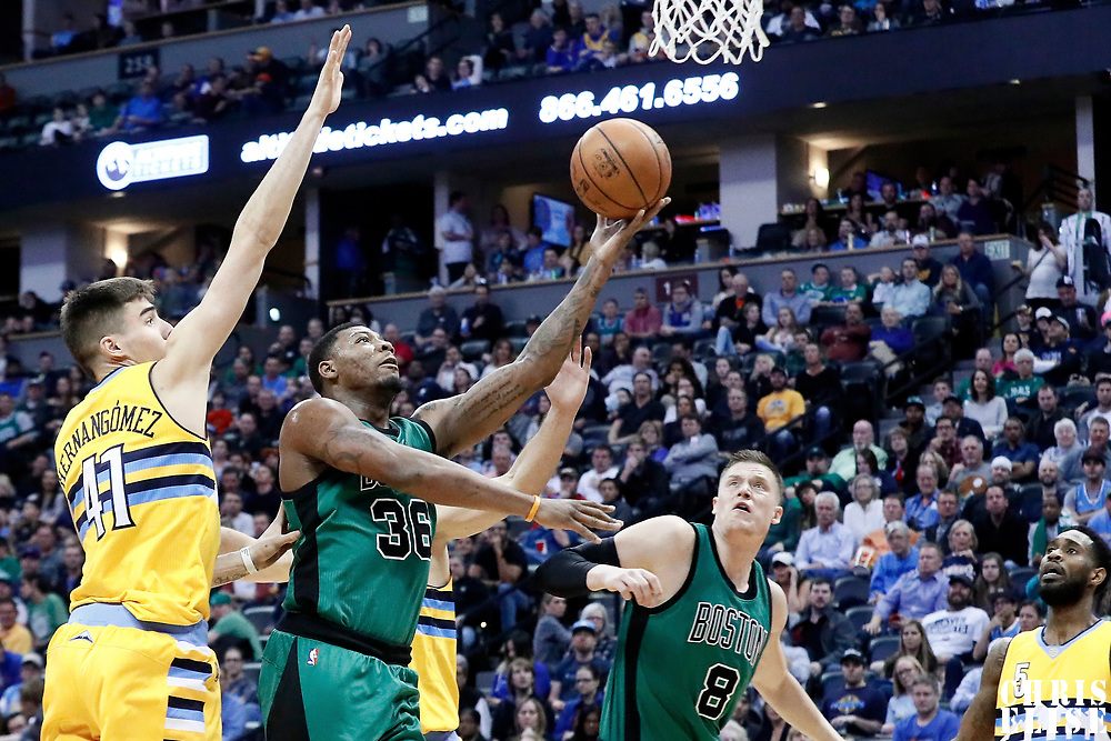 10 March 2017: Boston Celtics guard Marcus Smart (36) goes for the layup past Denver Nuggets forward Juancho Hernangomez (41) during the Denver Nuggets 119-99 victory over the Boston Celtics, at the Pepsi Center, Denver, Colorado, USA.
