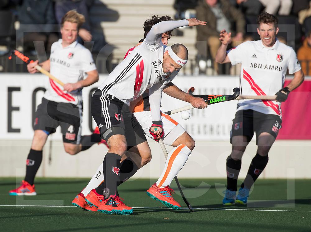 AMSTELVEEN - Justin Reid-Ross (A'dam)  tijdens   de hoofdklasse hockeywedstrijd AMSTERDAM-ORANJE ROOD (4-5). COPYRIGHT KOEN SUYK