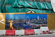 Construction hoarding showing the capital's landmarks and the River Thames, plus an overhead tarpaulin sheeting at the St George tower, on 2nd March 2017, at One Blackfriars, in the London borough of Southwark, England.
