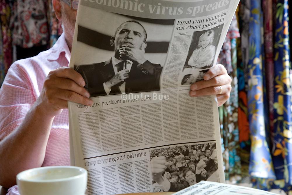 newspaper reader
