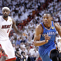 19 June 2012: Oklahoma City Thunder point guard Russell Westbrook (0) drives past Miami Heat shooting guard Dwyane Wade (3) during the first quarter of Game 4 of the 2012 NBA Finals, Thunder at Heat, at the AmericanAirlinesArena, Miami, Florida, USA.