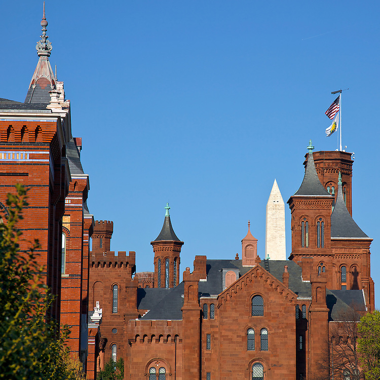 Yes, one of these things is not like the others. The Washington Monument pokes out from behind the historic Smithsonian castle skyline on the national mall in Washington, DC.