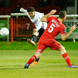Dover's forward Jamie Allen has a shot deflected by Hartlepool's defender Carl Magnay during the National League match between Dover Athletic FC and Hartlepool United FC at Crabble Stadium, Kent on 24 November 2018. Photo by Matt Bristow.