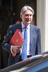 © Licensed to London News Pictures. 21/06/2017. London UK. Chancellor of the Exchequer leaving No:11 this morning heading to Parliament for the Queens speech marking the opening of Parliament. This years speech is expected to be overshadowed by 'day of rage protests' by left wing campaigners.  Photo credit: Andrew McCaren/LNP