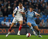 Photo: Paul Thomas.<br /> Manchester City v Portsmouth. The Barclays Premiership. 23/08/2006.<br /> <br /> Matt Taylor (L) of Portsmouth tries to push Joey Barton off the ball.