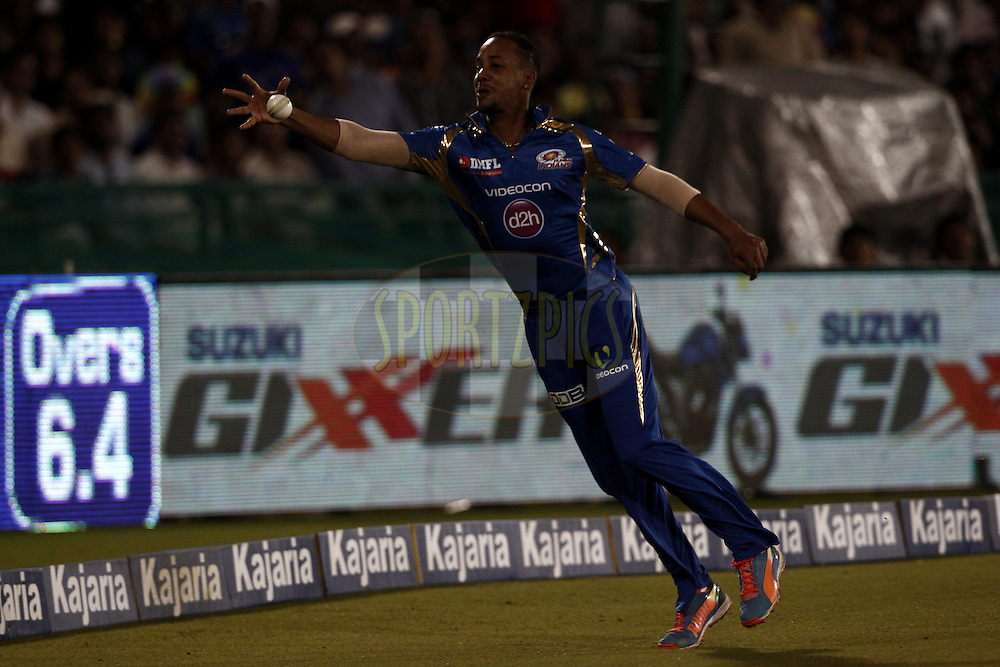 LMP Simmons of the Mumbai Indians trying to save boundary during the qualifier 4 match of the Oppo Champions League Twenty20 between the Mumbai Indians and the Southern Express held at the Chhattisgarh International Cricket Stadium, Raipur, India on the 14th September 2014<br /> <br /> Photo by:  Deepak Malik / Sportzpics/ CLT20<br /> <br /> <br /> Image use is subject to the terms and conditions as laid out by the BCCI/ CLT20.  The terms and conditions can be downloaded here:<br /> <br /> http://sportzpics.photoshelter.com/gallery/CLT20-Image-Terms-and-Conditions-2014/G0000IfNJn535VPU/C0000QhhKadWcjYs