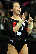 University of Utah junior Stephanie McAllister flashes the Ute sign to her fans just before her first of two vaults at the 2011 Women's NCAA Gymnastics Championship Individual Event Finals on April 17, in Cleveland, OH. McAllister tied for 13th place. (photo/Jason Miller)
