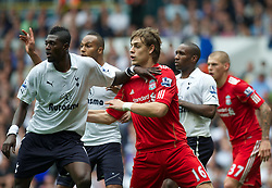 LONDON, ENGLAND - Sunday, September 18, 2011: Liverpool's Sebastian Coates battles with Tottenham Hotspur's Emmanuel Adebayor on his club debut during the Premiership match at White Hart Lane. (Pic by David Rawcliffe/Propaganda)
