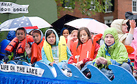 "Due to the heavy rains Saturday morning Gilford Library float riders felt like they spent a day ""in"" the lake rather than ""on"" the lake during the Gilford Old Home Day parade.  (Karen Bobotas/for the Laconia Daily Sun)"