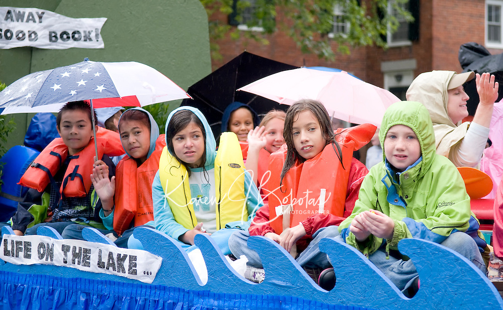 """Due to the heavy rains Saturday morning Gilford Library float riders felt like they spent a day """"in"""" the lake rather than """"on"""" the lake during the Gilford Old Home Day parade.  (Karen Bobotas/for the Laconia Daily Sun)"""