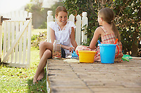 Two girls (7-9 10-12) playing on garden