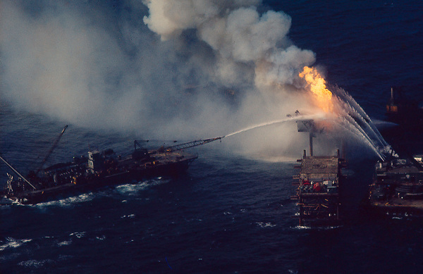 Stock photo of an offshore drilling rig on fire in Gulf of Mexico.stock picture,stock image