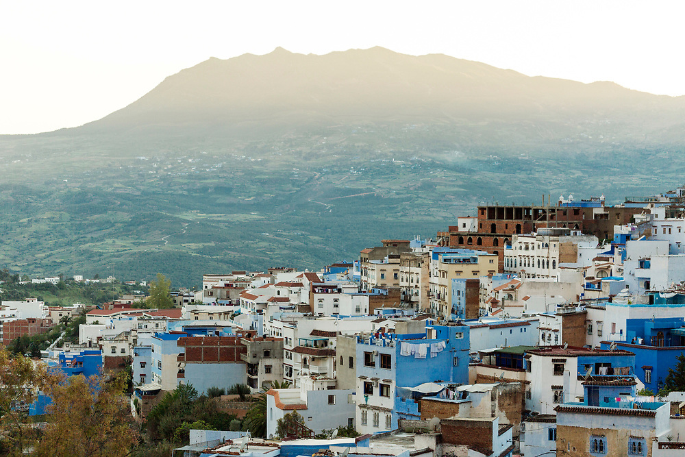 View of the Chefchaouen Medina - the blue city- amid Rif Mountain landscape setting, Rif region of Northern Morocco, 2016-04-27.