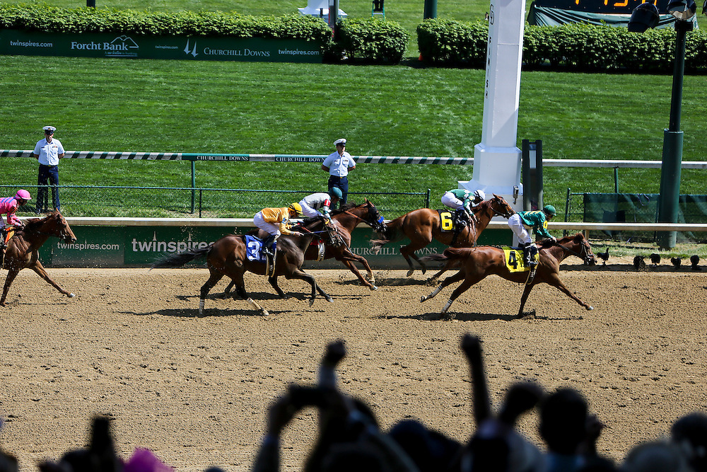 LOUISVILLE, KY - MAY 06: A fan cheers as horses cross the finish line during a undercard race leading up to the 142nd running of the Kentucky Oaks at Churchill Downs on May 06, 2016 in Louisville, Kentucky. (Photo by Michael Reaves/Getty Images)