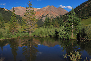 A subtle reflection of Redcloud and Sunshine peaks in the San Juan Range, Colorado.