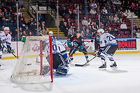 KELOWNA, CANADA - OCTOBER 5: Conner Bruggen-Cate #20 of the Kelowna Rockets takes a shot on the net of Griffen Outhouse #30 of the Victoria Royals  on October 5, 2018 at Prospera Place in Kelowna, British Columbia, Canada.  (Photo by Marissa Baecker/Shoot the Breeze)  *** Local Caption ***