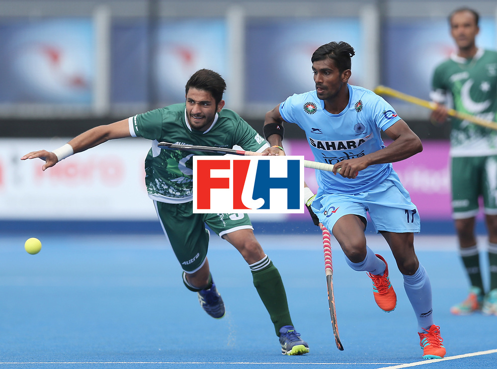 LONDON, ENGLAND - JUNE 24: Abu Mahmood of Pakistan and Sumit of India battle for possession  during the 5th-8th place match between Pakistan and India on day eight of the Hero Hockey World League Semi-Final at Lee Valley Hockey and Tennis Centre on June 24, 2017 in London, England. (Photo by Alex Morton/Getty Images)