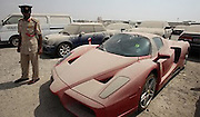 Most expensive police sale in history: Limited edition £1million Ferrari abandoned to the Dubai dust after debt-ridden British owner flees country to be auctioned off <br /> <br /> A £1million limited edition Ferrari is to be auctioned in what is thought to be the most expensive police sale in history, it was revealed today.<br /> The exclusive Enzo, one of only 399 in the world, was impounded by officers last year after it was abandoned in a car park and covered in dust in Dubai.<br /> It is to go under the hammer on Wednesday among 23 luxury vehicles in a special supercar police sale, local officers confirmed today.<br /> The red motor - owned by a Brit - is one of the top 10 fastest ever road cars ever produced.<br /> It is thought the owner was being chased for unpaid traffic fines after abandoning the supercar 20 months ago.<br /> Lots of expats abandon their expensive cars because in Dubai being in debt is a crime.<br /> <br /> Many then skip the country to avoid jail and until recently they were automatically put on the Interpol wanted list by the rich Arab state's authorities.<br /> There is no suggestion that the British owner - who has not been named - was involved in serious criminality.<br /> The supercar has an eye-watering 5998c aluminium V12 engine capable of 660bhp and a top speed of 217mph.<br /> <br /> It can reach 0-60mph in just 3.4 seconds and Enzos, first built in 2002, are so rare that every time one crashes the others increase in value.<br /> The Enzo is the prize of the auction, but it will be joined in the sale by three other Ferraris, as well as seven top-of-the-range Porsches, Corvettes, Mercedes, BMWs, Infinitis, Range Rovers and Dodges.<br /> But it was inexplicably left to gather dust in a compound in the Gulf nation and was seized in June 2011.<br /> <br /> Now it will go up in front of bidders in what looks set to be the most lucrative police auction of lost and found goods in history.<br /> A total of 129 cars will be auctioned starting at 9am on Wednesday morning at the Al Quasis auction.<br /> An official added: 'There is a black Ferrari wo