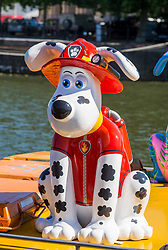 "© Licensed to London News Pictures.  27/06/2018; Bristol, UK. ""Marshall"" Gromit character at the Gromit Unleashed 2, official launch at Bristol Harbourside. Gromit Unleashed 2 will see the Academy Award®-winning character Gromit by Nick Park at Aardman Animations returning to Bristol in 2018 for the second time on sculpture trails to raise money for  the Grand Appeal charity. The character of Gromit will be joined by Wallace and arch nemesis Feathers McGraw.<br /> The trail will feature over 60 giant sculptures, including a new WG Grace cricketing Gromit, designed by high-profile artists, designers, innovators and local talent. Sculptures will be positioned in high footfall and iconic locations around Bristol and the surrounding area, for a family day out around the city and beyond. Photo credit: Simon Chapman/LNP"
