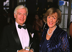 MR & MRS STEPHEN RUBIN he is chairman of Pentland Group PLC at a dinner in London on 6th July 1998.MIX 14