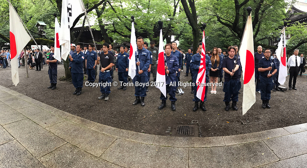 August 16, 2017, Tokyo, Japan: Always in attendance at Yasukuni Shrine on the anniversary of WW II are rightists and nationalists who come to flaunt their pratrotic pride. This time it was on the 72nd anniversary and tens of thousand came out in the rain to pay their respects for Japan's war dead. Yasukuni Shrine is the national Shinto shrine where nearly 2.5 million war dead from the past 150 years are enshrined. Visits to Yasukuni by top Japanese politicians continue to outrage China and South Korea because it honors 14 World War II class A war criminals who are also enshrined there. Even so, dozens of Japanese lawmakers visited Yasukuni Shrine today, while PM Shinzo Abe sent a ritual offering via his emissary. Photo by Torin Boyd.