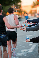 Runner takes water during a marathon race