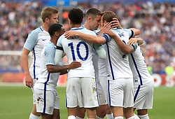 England's Harry Kane celebrates scoring his side's first goal of the game with teammates during the International Friendly at the Stade de France, Paris.