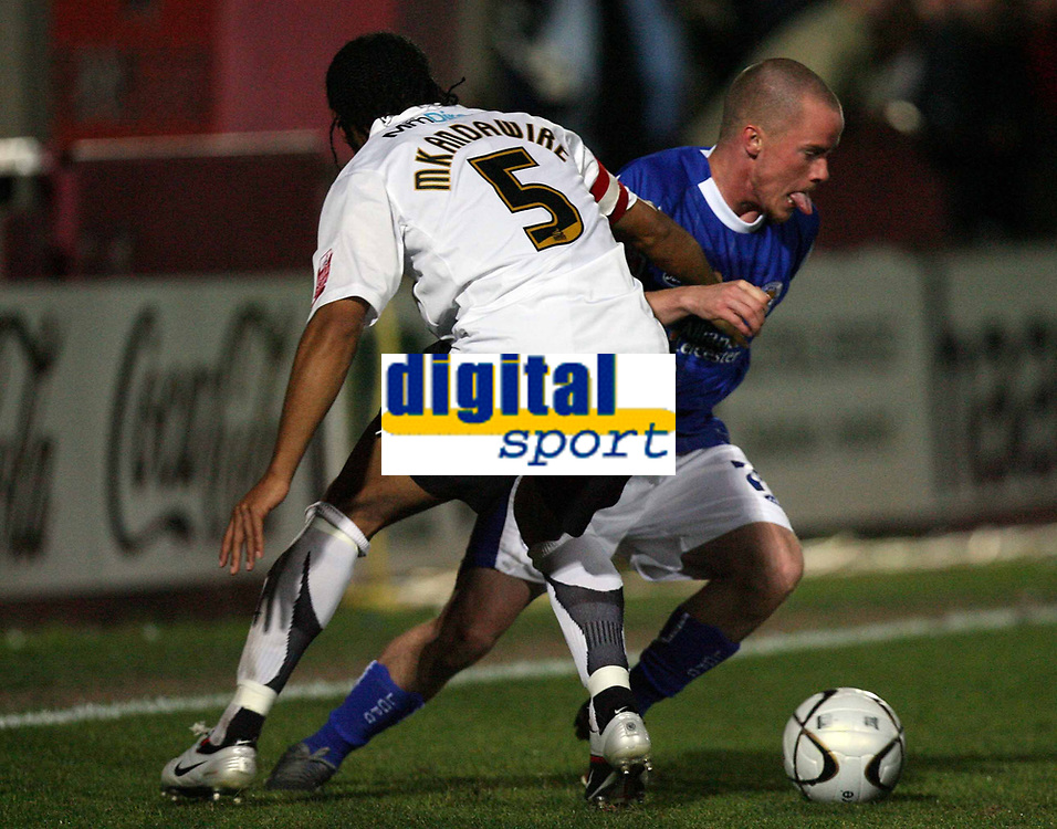 Photo: Rich Eaton.<br /> <br /> Hereford United v Leicester City. Carling Cup. 19/09/2006. Leicester goalscorer Iain Hume right, turns inside Hereford captain Tamika Mkandawire