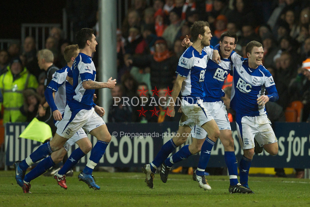 BLACKPOOL, ENGLAND - Tuesday, January 4, 2011: Birmingham City's Scott Dann celebrates scoring the second goal past Blackpool's goalkeeper Richard Kingson during the Premiership match at Bloomfield Road. (Pic by: David Rawcliffe/Propaganda)