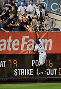 New York Yankees left fielder Brett Gardner leaps but can't catch Chicago White Sox Jose Abreu's three-run home run during a baseball game, Aug. 22, 2014, in New York.<br /> (AP Photo/Kathy Kmonicek)