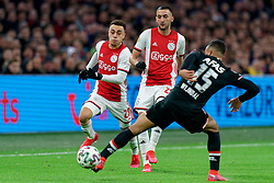 Sergiño Dest #28 of Ajax, Hakim Ziyech #22 of Ajax and Owen Wijndal #15 of AZ Alkmaar in action during the Dutch Eredivisie match round 25 between Ajax Amsterdam and AZ Alkmaar at the Johan Cruijff Arena on March 01, 2020 in Amsterdam, Netherlands