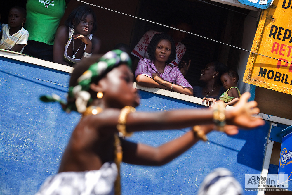 Residents watch from balconies during the parade held on the occasion of the annual Oguaa Fetu Afahye Festival in Cape Coast, Ghana on Saturday September 6, 2008..