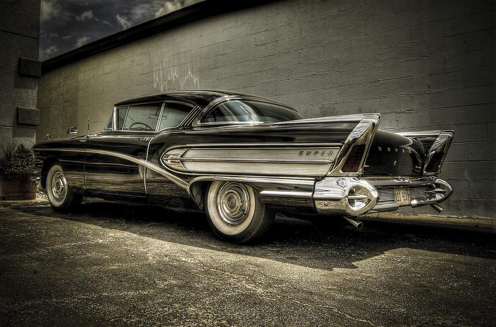 Vintage Black Buick Riviera with rocket fins