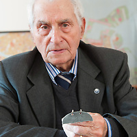 VENICE, ITALY - APRIL 03:Ê Auschwitz Survivor Antonio Boldrin poses for a portrait while holding the metal stamp with his concentration camp number on April 3, 2012 in Venice, Italy. Sentenced to death and already in front of the execution fire squad Boldrin was rescued by the Russian Army and was one of the few lucky prisoners that managed to survive the concentration camp. (Photo by Marco Secchi/Getty Images)