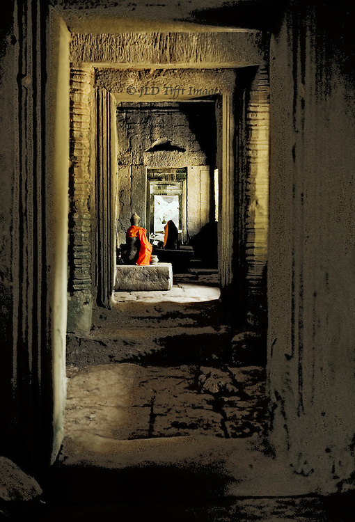 Angkor, Ta Prohm, perspective along an interior corridor toward a modern Buddhist shrine.