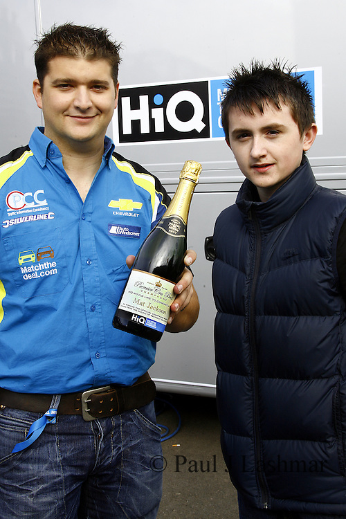Driver Mat Jackson get his champagne moment award from fan, Jordan Batts.